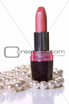 a pink lipstick with perl on white