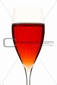 a red champage glass with alcohol