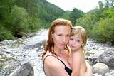 mother daughter playing in river after swimming