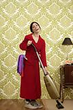 Bathrobe retro housewife woman vacuum cleaner
