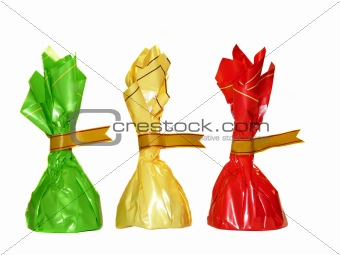 Three colorful candies isolated on white background