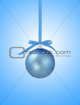 Blue christmas ball with ribbon on blue background with copy spa