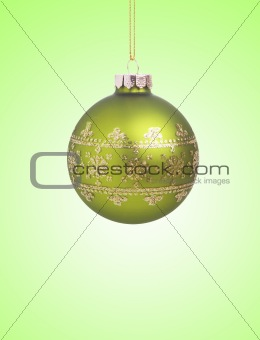 Green christmas ball with ribbon on green background with copy s