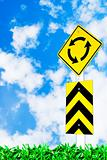 traffic circle road sign on beautiful sky