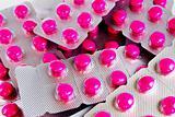 pack of pink medicine pills background