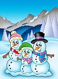 Winter theme with snowman family