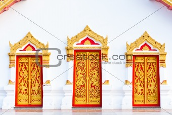 three painting craved doors