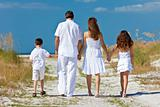 Mother, Father and Children Family Walking At Beach