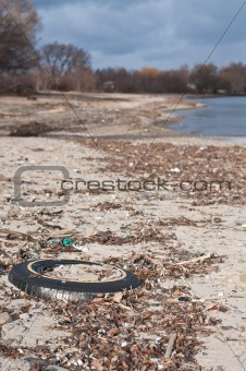 Tire and Other Litter on a Beach