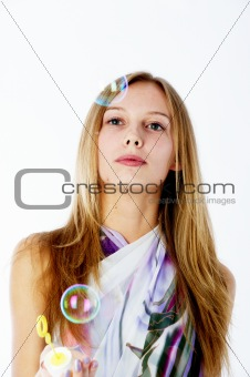 Attractive girl with soap bubbles