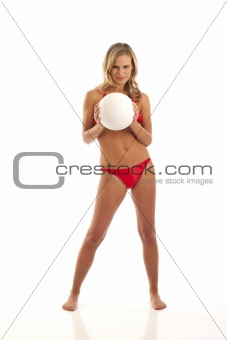 Young woman holding volleyball