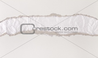 Torn paper strips series - cardboard revealing paper
