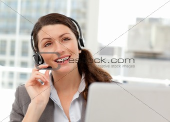 Thoughtful businesswoman talking on the phone while working