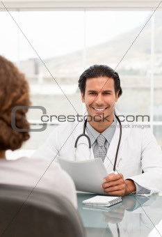Positive doctor during a appointment with a female patient