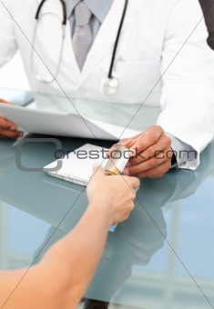 Close up of a doctor giving medicine to his patient