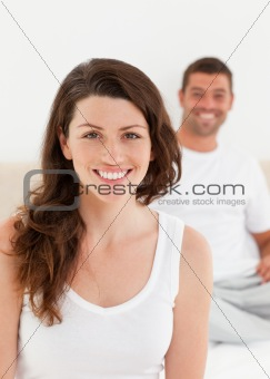 Adorable woman sitting on her bed with her boyfriend