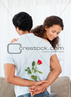 Beautiful woman finding a rose hidden by his boyfriend