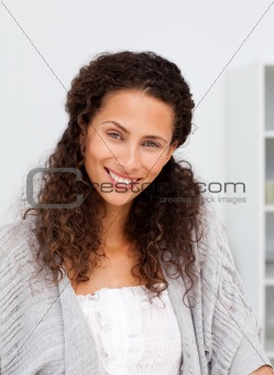 Cute woman looking at the camera standing in a kitchen