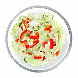Healthy salad with vegetables in a stylish glass bowl isolated on white background