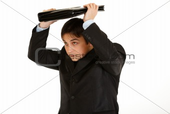 Young businessman holding briefcase over  head