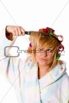 housewife with hairbrush