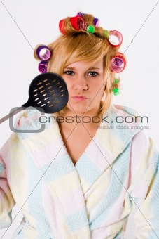 funny housewife with curlers and skimmer