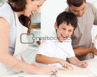 Caucasian family cooking biscuits together