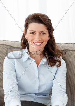 Beautiful businesswoman relaxing on the sofa