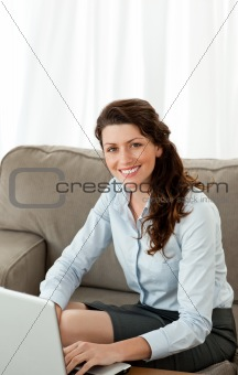 Beautiful businesswoman working with her laptop