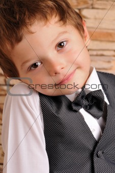 boy in a suit and bow tie