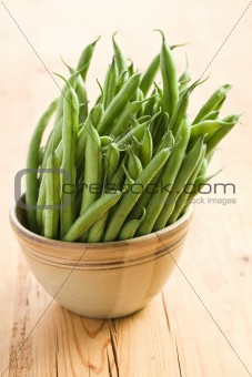 bean pods in brown bowl