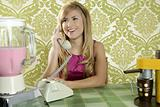 Retro vintage woman kitchen talking phone smiling