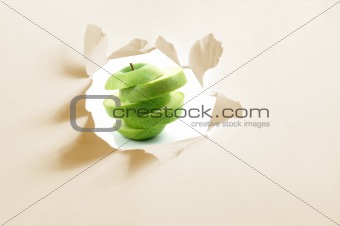 sliced apple and hole in paper