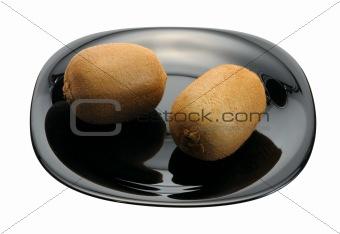Kiwi on a black plate