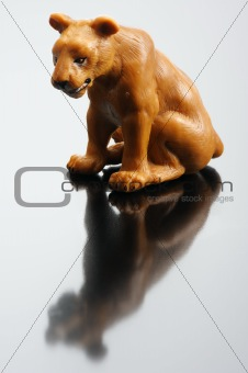 A plastic figurine of a lioness