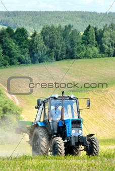 Tractor in a field in early summer