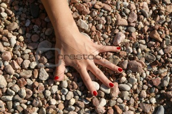 arm and pebbles