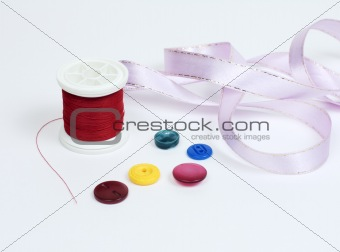 Threads with buttons and tape
