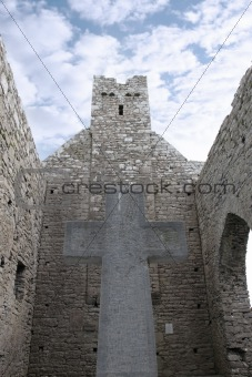 cross and historic walls