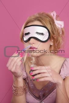 blond woman smelling perfume sleep mask blind