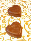 Mouthwatering chocolates in a heart-shaped on a colored background
