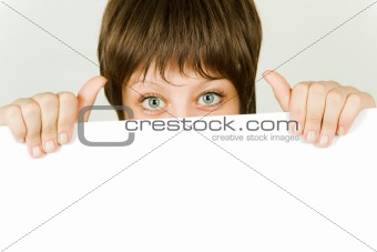 girl hiding behind a white banner