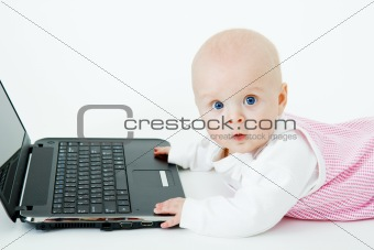 baby with laptop in studio