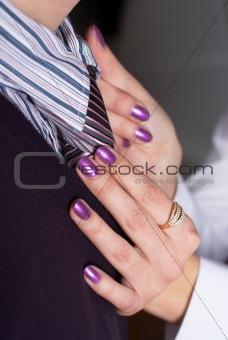 Tie correction on businessman
