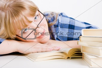 blonde in glasses with books