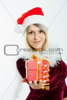 beautiful blonde in a Christmas hat with gifts