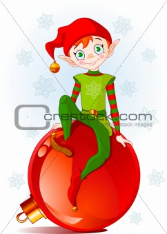 Elf sitting on Christmas ball