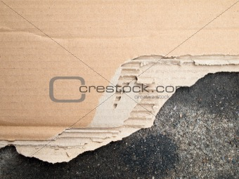 Torn brown cardboard paper