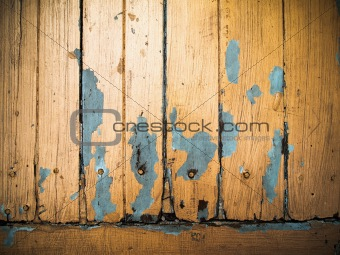 Old grunge wood panel painted orange