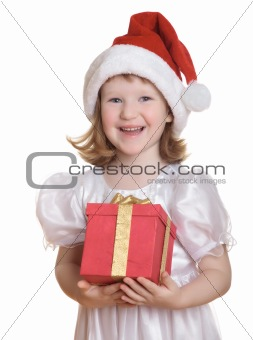 Baby girl in Santa's hat holding her Christmas present